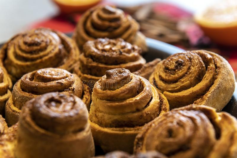 Freshly baked homemade cinnamon rolls buns. With cocoa and spices, Christmas pastries, close-up royalty free stock photography