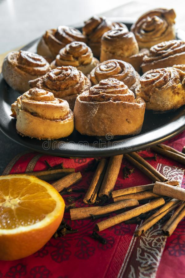 Freshly baked homemade cinnamon rolls buns. With cocoa and spices, Christmas pastries, close-up stock image