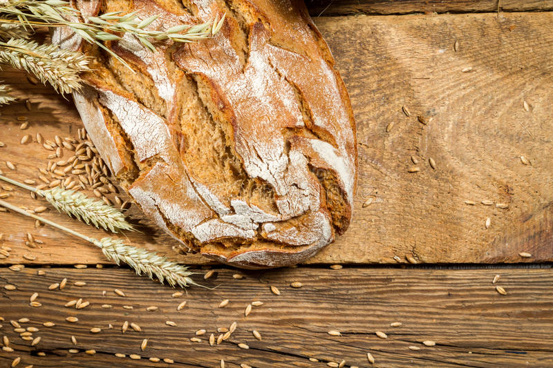 Freshly baked loaf of bread royalty free stock photography
