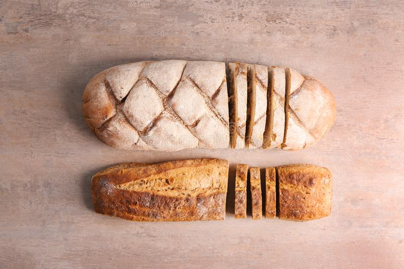 Freshly baked loaves on gray background royalty free stock photos