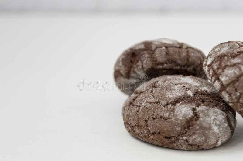Freshly baked marble cookies with cracks, isolated on white background. Macro Image royalty free stock photos