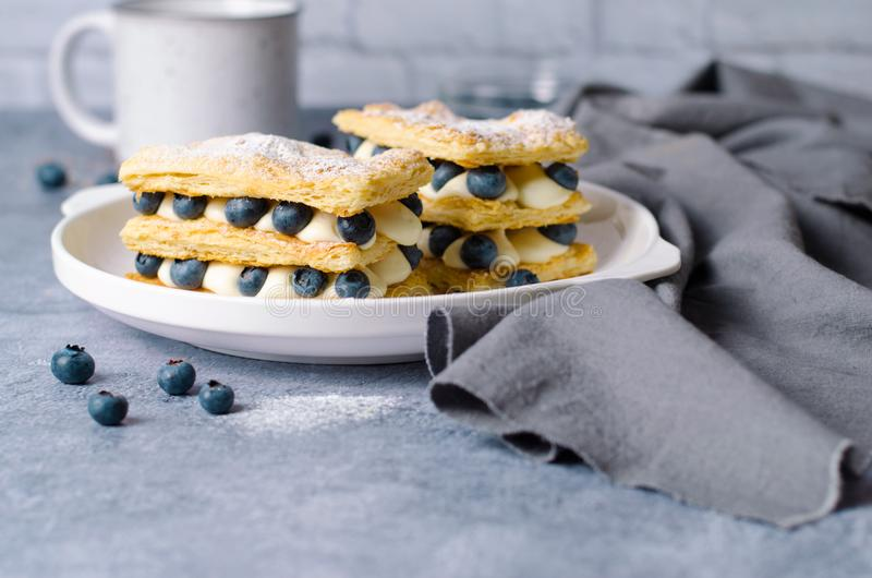 Freshly Baked Millefeuille Cake with Puff Pastry, Cream and Blueberry royalty free stock photography