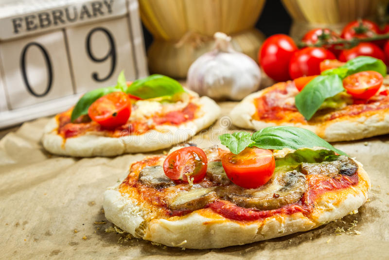 Freshly baked mini pizzas stock image