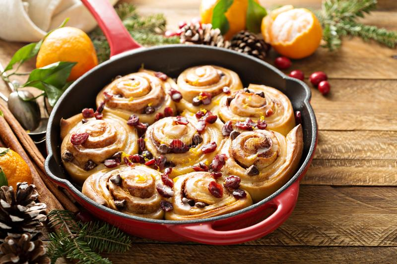 Freshly baked orange and cranberry cinnamon rolls royalty free stock photos