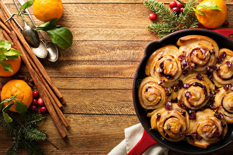 Freshly baked orange and cranberry cinnamon rolls royalty free stock photography