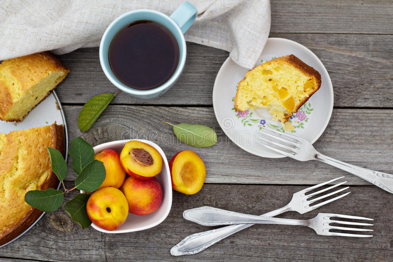 Freshly baked peach cake with tea stock images