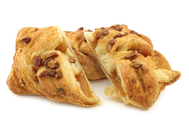 Freshly baked pecan buns with apricot filling stock photos