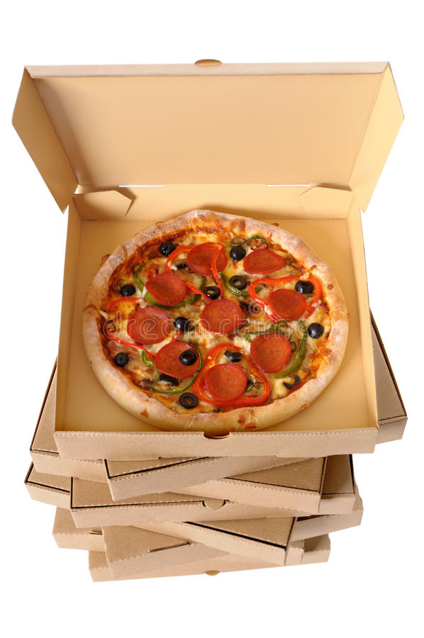 Pizza boxes stack, fresh pizza inside royalty free stock image