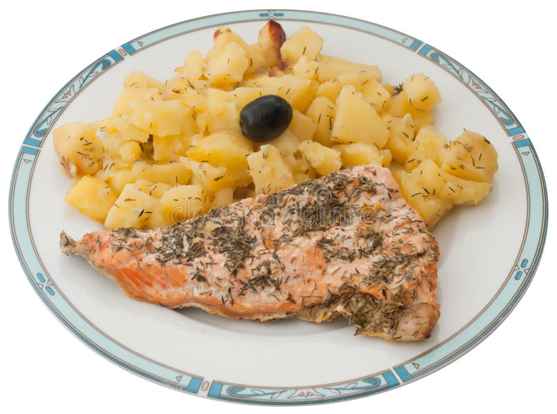 Freshly baked potatoes and salmon fish. Plate with freshly baked potatoes and salmon fish, cooked with olive oil, lemon juice, rosemary, thyme, salt, pepper and royalty free stock photo