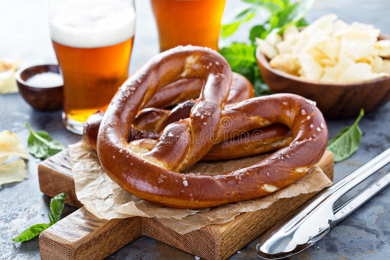 Freshly baked pretzels with beer stock image