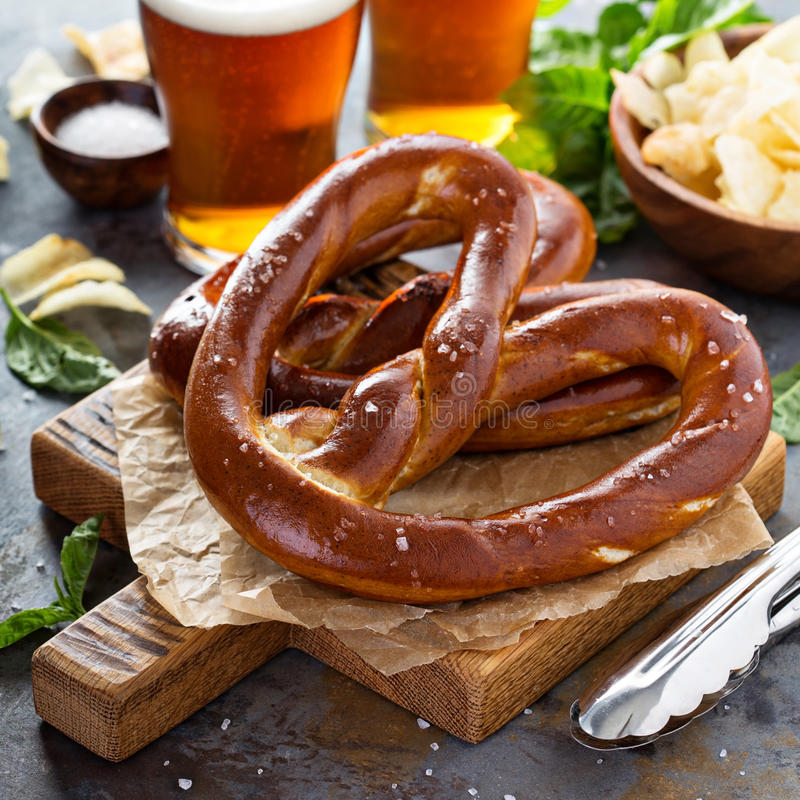 Freshly baked pretzels with beer stock photo