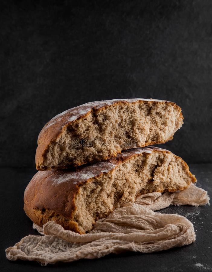 Freshly baked rye, sourdough bread, rustic studio picture royalty free stock photography