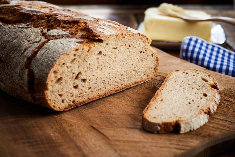 Freshly baked sliced loaf of rye bread in closeup royalty free stock image