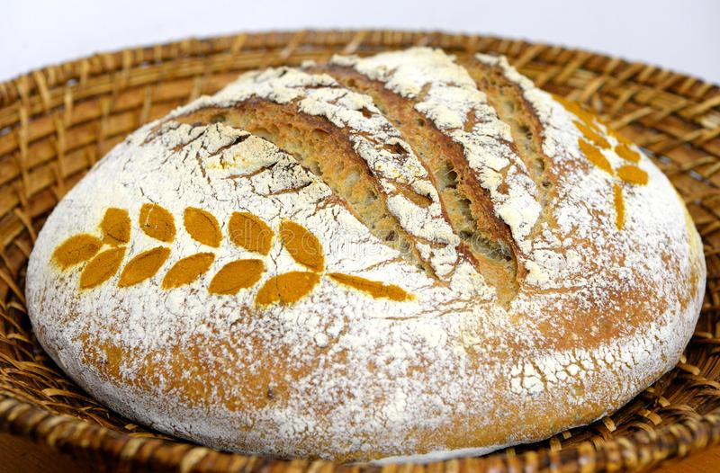 Freshly baked sourdough bread in a basket royalty free stock image