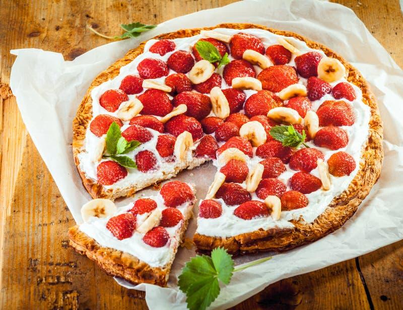 Freshly baked strawberry and banana flan stock photography