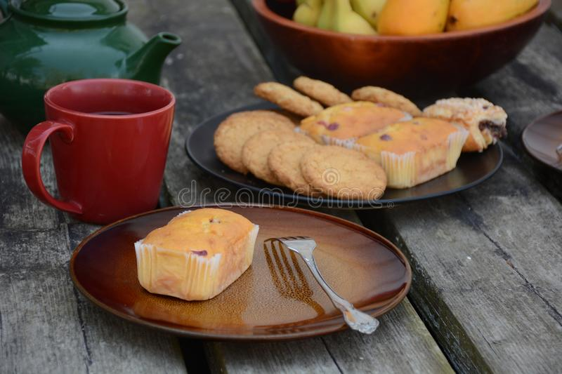 The freshly baked sweet mini loaves on rustic wooden background. Breakfast with a sweet mini loaves. The mini loaves with cranberry, poppy seed and mixed stock photo