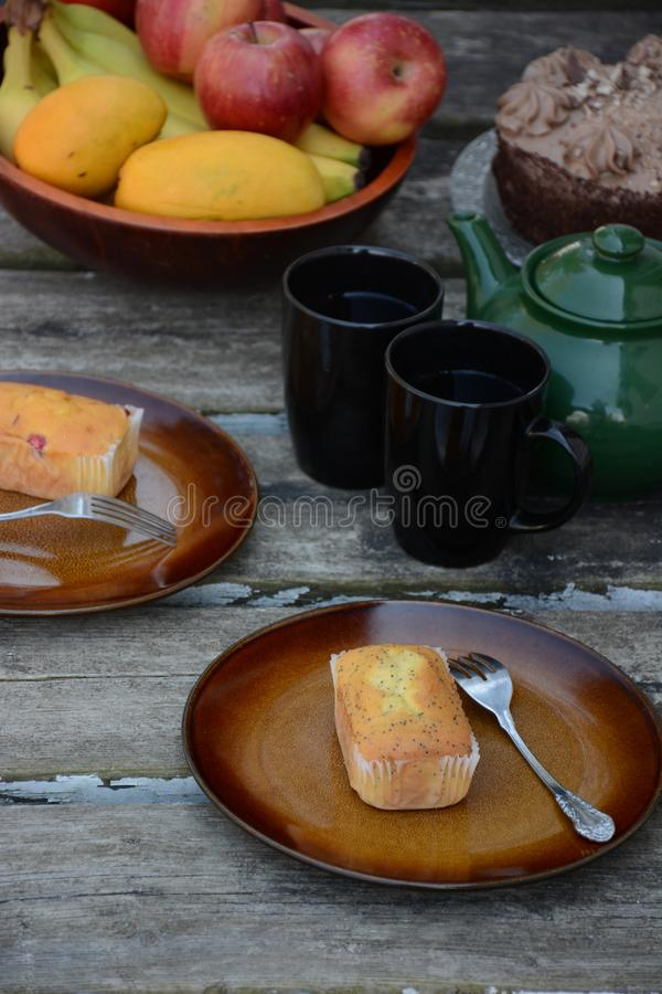 The freshly baked sweet mini loaves on rustic wooden background. Breakfast with a sweet mini loaves. The mini loaves with cranberry, poppy seed and mixed royalty free stock images