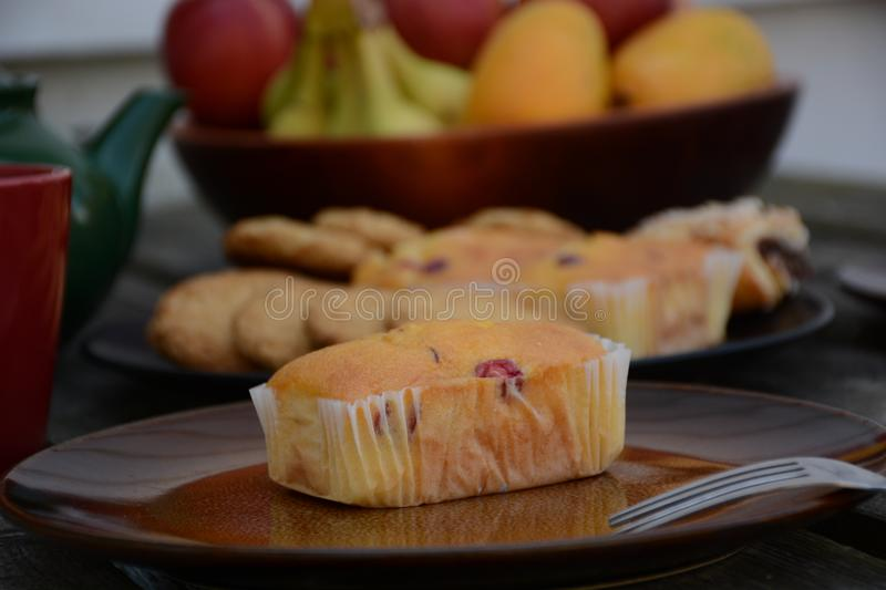The freshly baked sweet mini loaves on rustic wooden background. Breakfast with a sweet mini loaves. The mini loaves with cranberry, poppy seed and mixed stock photos