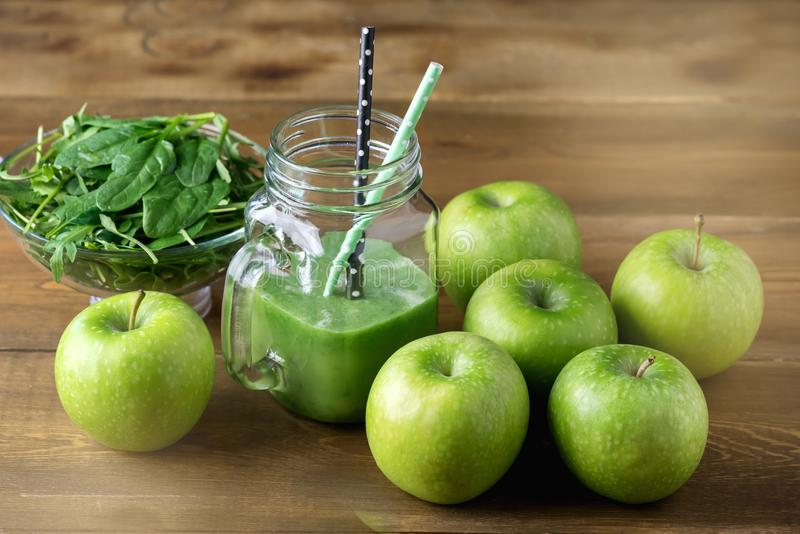 Freshly Blended Green Fruit Smoothie in Glass Jar with Straw. Spinach Arugula Green Apple Detox Healthy Food stock image