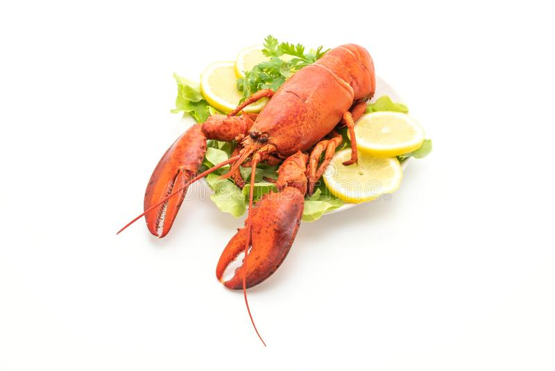 freshly boiled lobster with vegetable and lemon stock images