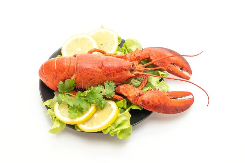 freshly boiled lobster with vegetable and lemon stock image