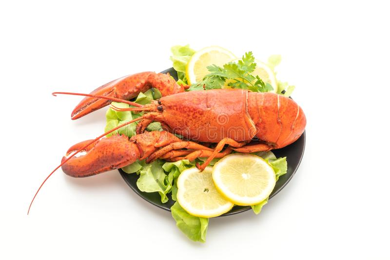 freshly boiled lobster with vegetable and lemon stock photos