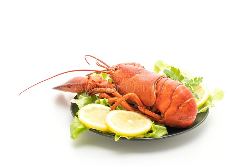 freshly boiled lobster with vegetable and lemon royalty free stock photo