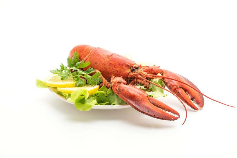 freshly boiled lobster with vegetable and lemon royalty free stock image