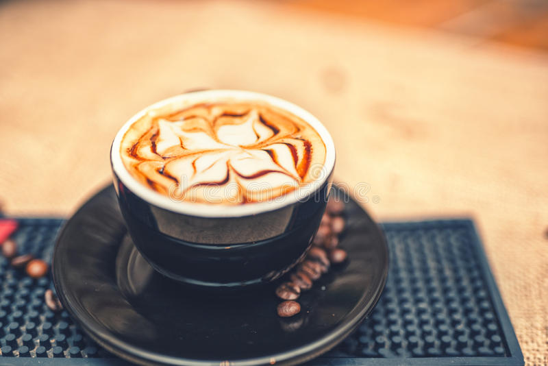 Freshly brewed coffee on the counter at local pub, mixed with milk. Soft effect royalty free stock image