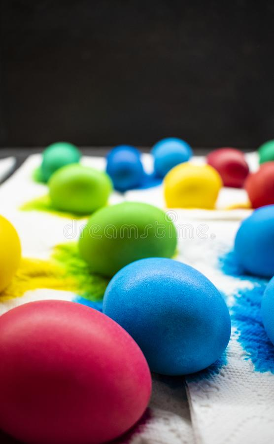 Freshly colored Easter eggs on paper napkin. royalty free stock images