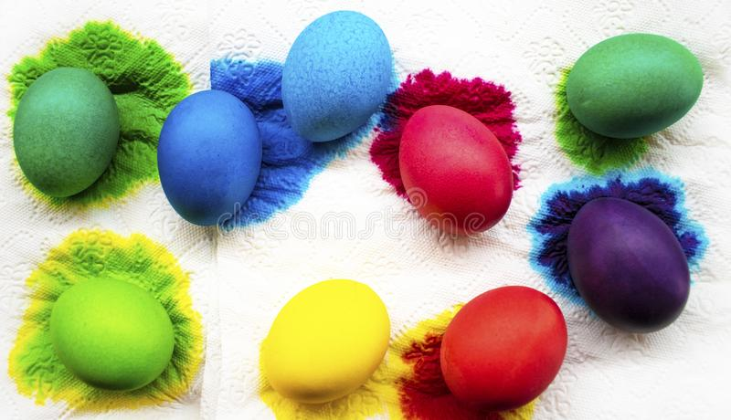 Freshly colored Easter eggs on paper napkin. stock images