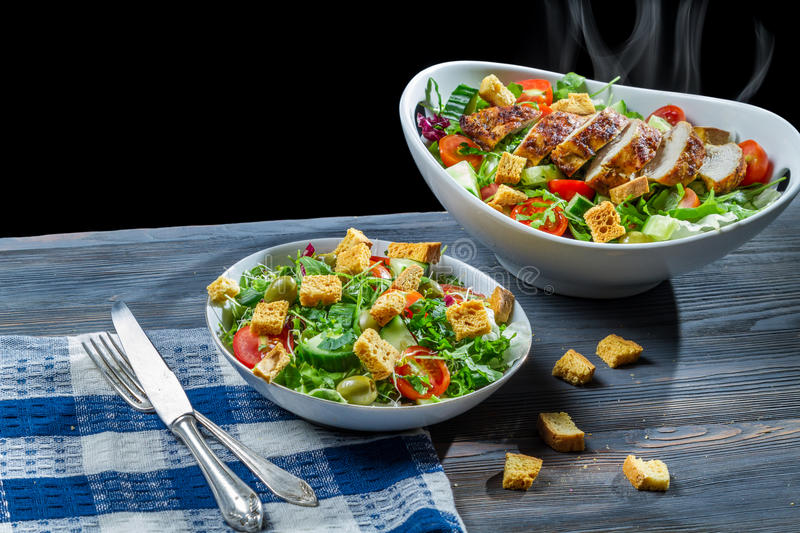 Freshly cooked chicken and salad made of vegetables royalty free stock image