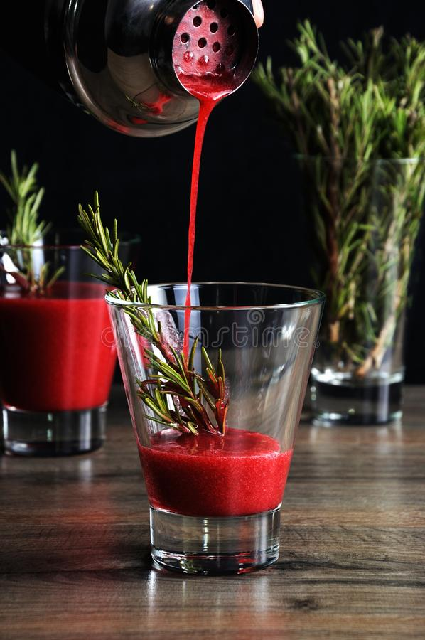 Freshly cooked cranberry juice. Freshly made cranberry juice with a sprig of rosemary stock photos