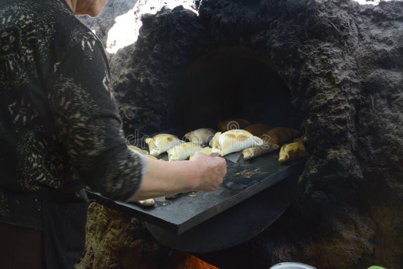 The freshly cooked empanadas stock image