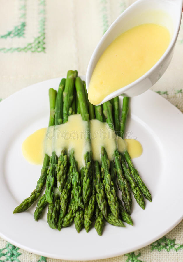 Freshly cooked green asparagus with hollandaise sauce stock photo