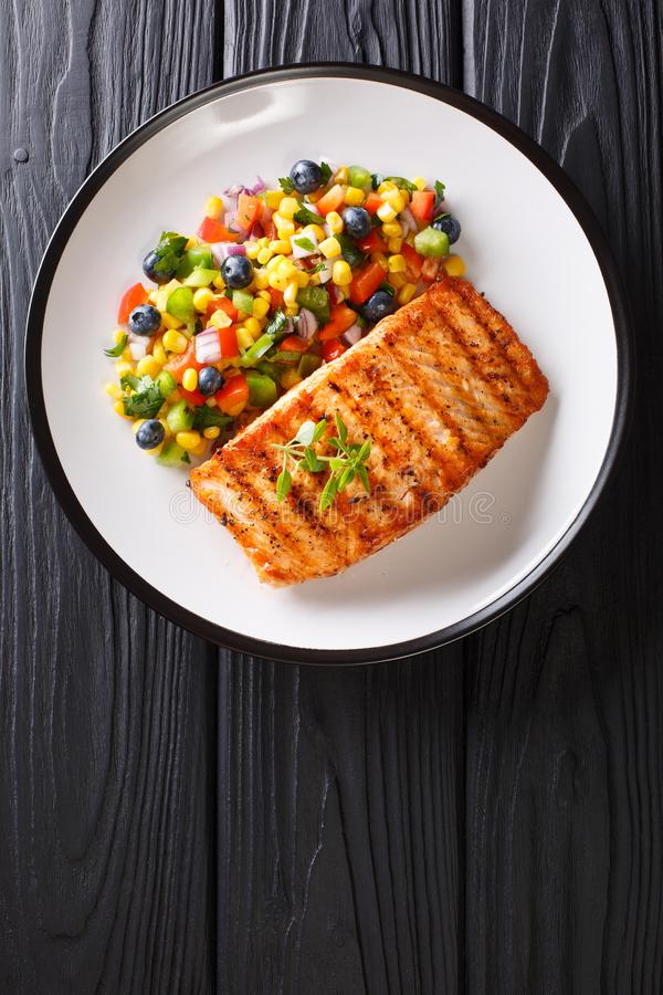 Freshly cooked grilled salmon filet with pepper, corn, blueberry stock images