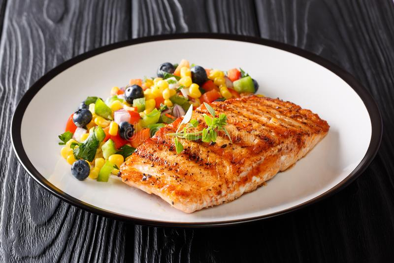Freshly cooked grilled salmon filet with pepper, corn, blueberry royalty free stock photography