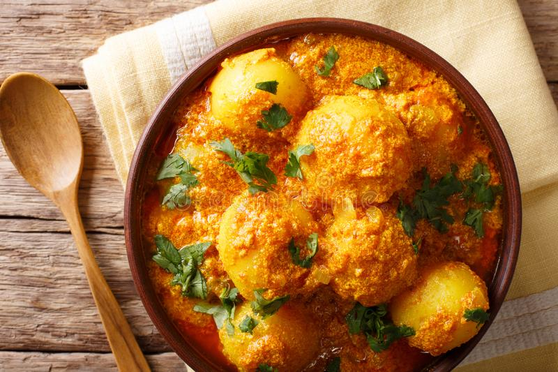 Freshly cooked Indian potatoes Dum aloo in curry sauce close-up. Horizontal top view stock photography
