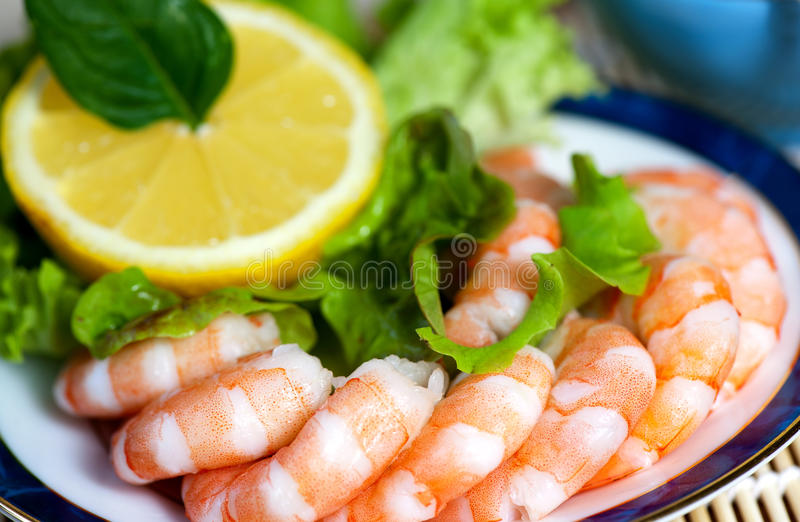 Freshly cooked prawns on a plate stock photography