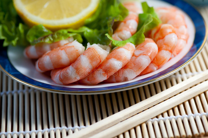 Freshly cooked prawns on a plate royalty free stock photo