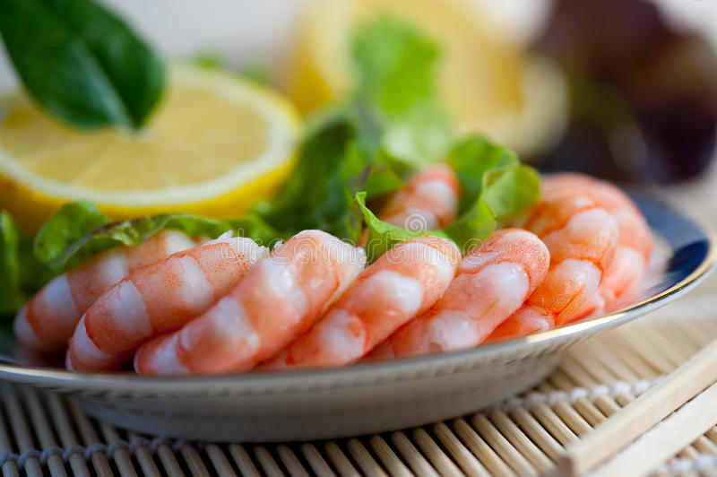 Freshly cooked prawns on a plate royalty free stock images
