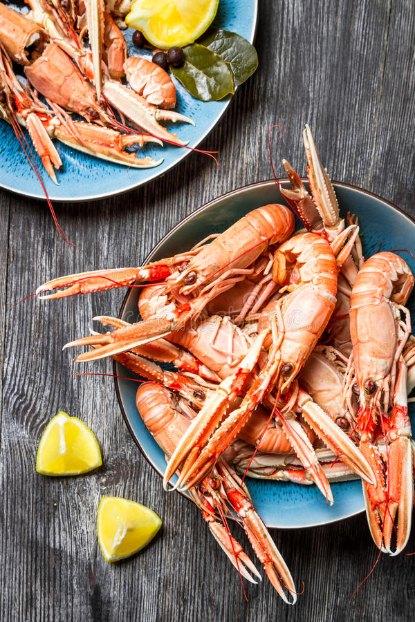 Freshly cooked scampi served with lemon royalty free stock photography