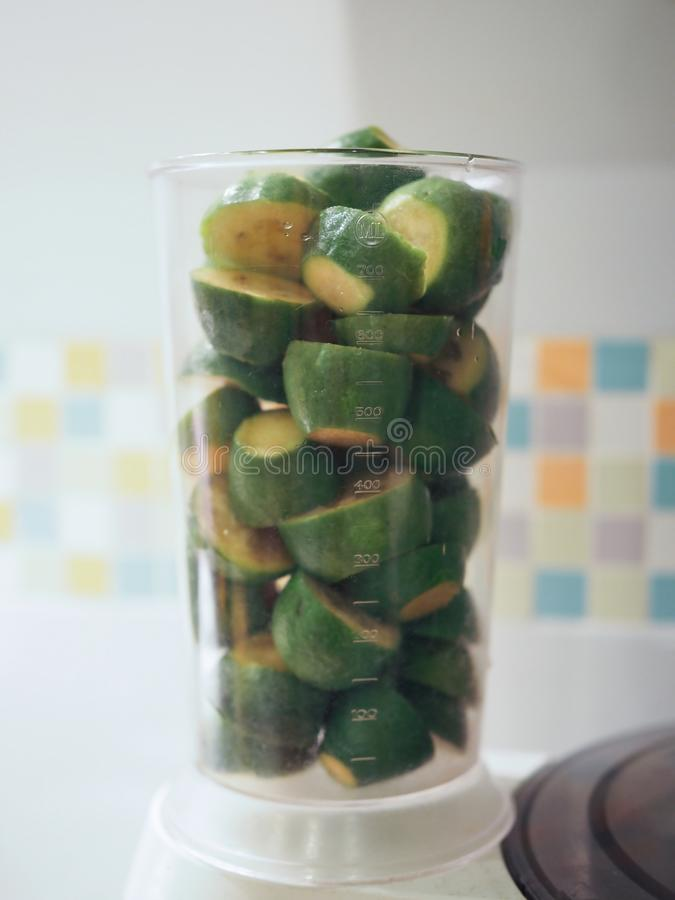 Freshly cut pieces of feijoa fruit close-up. preparing to make jam.  royalty free stock images