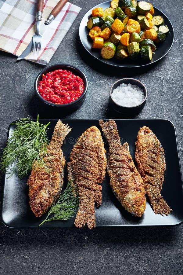 Freshly fried crispy crucian carps, top view stock photos