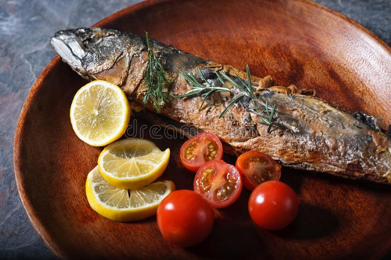 Freshly fried fish with vegetables stock image