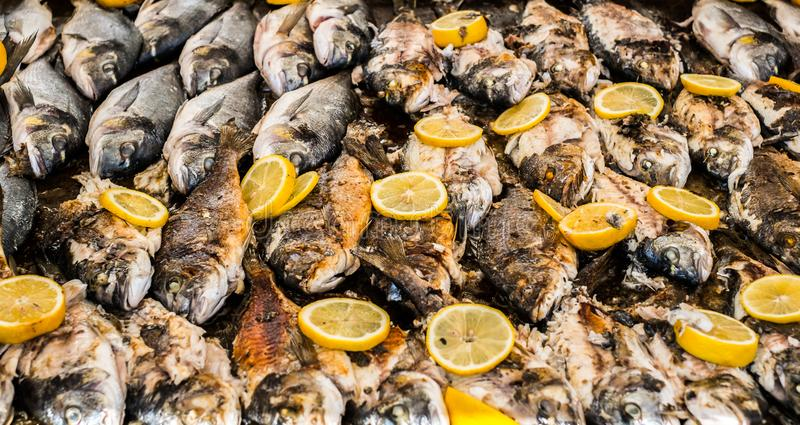 Freshly grilled fish with slices of lemon stock photography