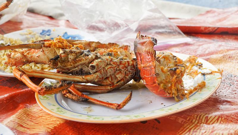 Freshly grilled Lobster on Union Island in the Tobago Cays of Saint Vincent and the Grenadines, Caribbean. stock photo