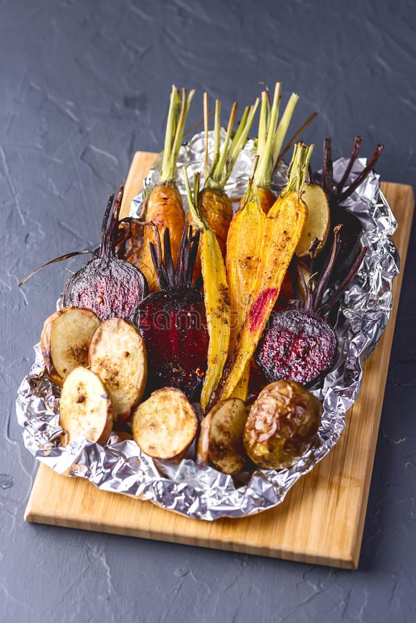 Freshly Grilled Vegetables Tasty Diet Vegan Food Grilled Carrots Beet and Potato Vertical royalty free stock image