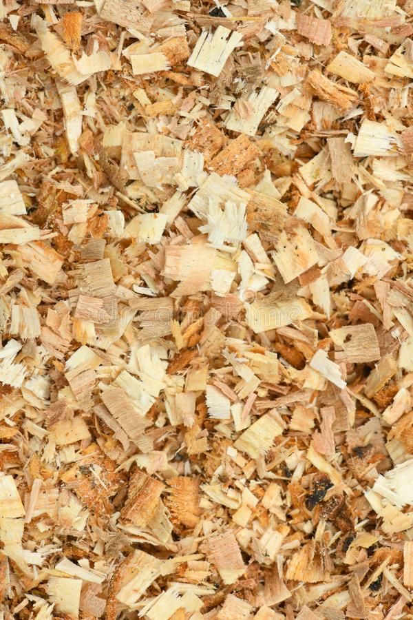 A Freshly Laid Layer of Large Garden Bark Woodchips. Woodchips used as safe soft surface in a childrens play park, Top Down View. High resolution photo. Full royalty free stock photo