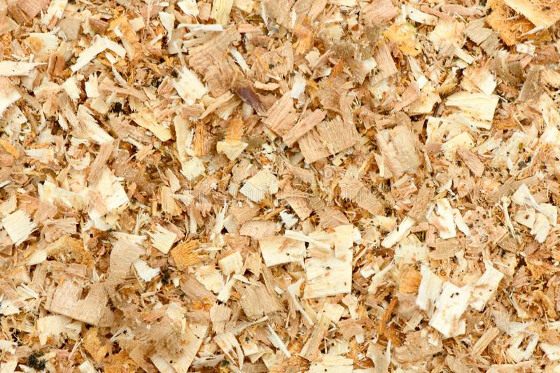 A Freshly Laid Layer of Large Garden Bark Woodchips. Woodchips used as safe soft surface in a childrens play park, Top Down View. High resolution photo. Full stock photos